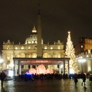 Overall view on the Saint Peter´s square with the illuminated sand Nativity and the Christmas tree.